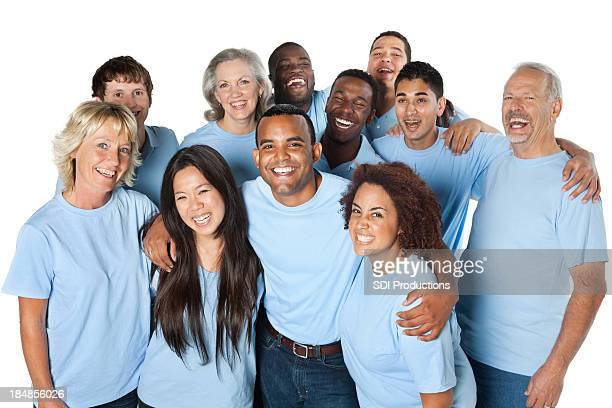 Laughing group of people together, all in blue shirts