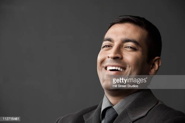 Laughing Hispanic businessman