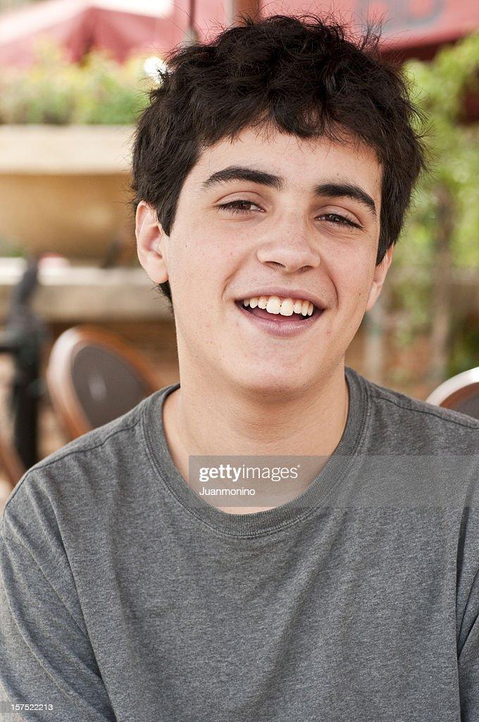 Laughing Hispanic Teenage Boy Stock Photo