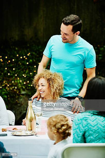 Laughing husband and wife at outdoor party