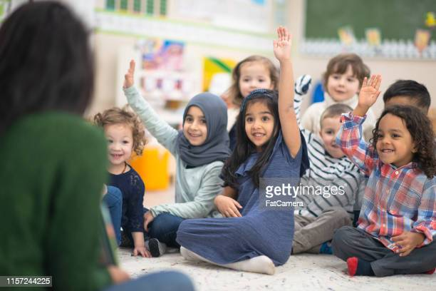 laughing kids - refugee stock pictures, royalty-free photos & images