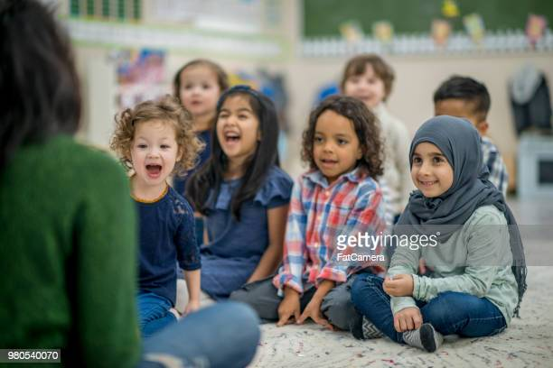 laughing kids - migrant children stock photos and pictures