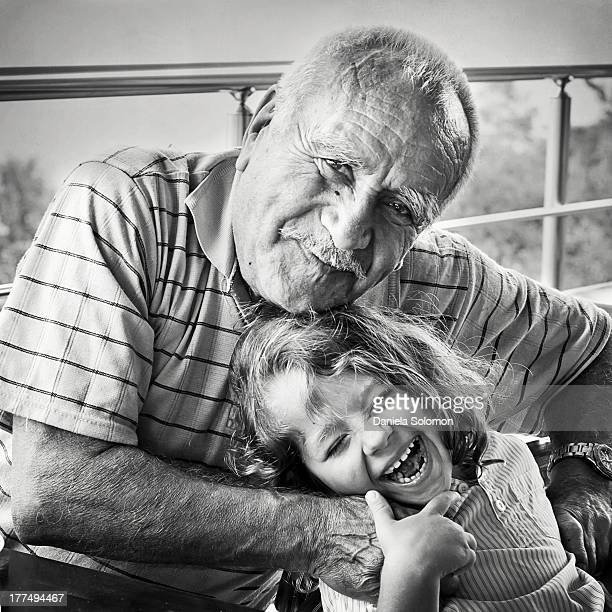 Laughing little boy with his grandfather