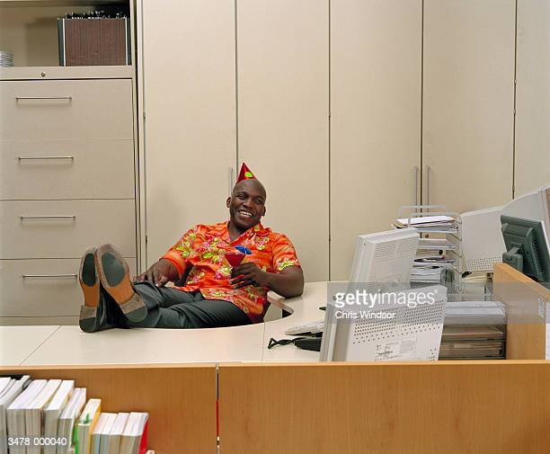 laughing man at office party - hawaiian shirt stock photos and pictures