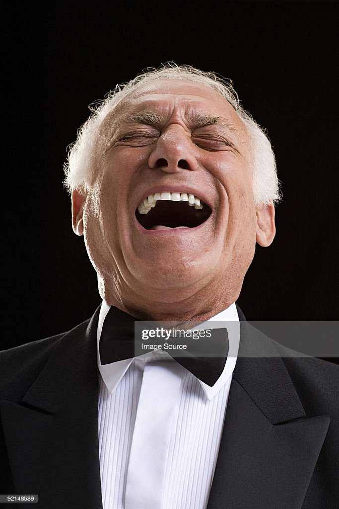 Laughing man in a dinner jacket : Stock Photo