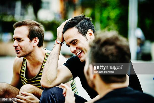 Laughing man with friends after soccer game