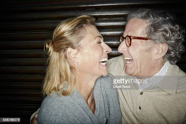 Laughing mature couple on bench