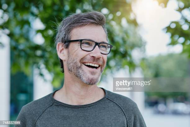 laughing mature man outdoors - only mature men stock pictures, royalty-free photos & images