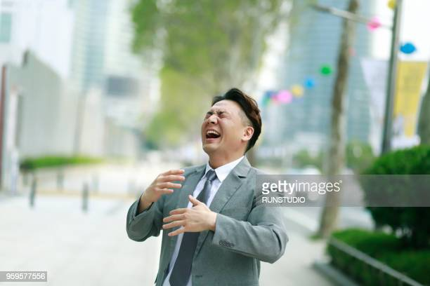 laughing middle aged businessman outdoors - 笑う ストックフォトと画像