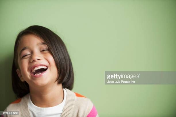 Laughing mixed race girl