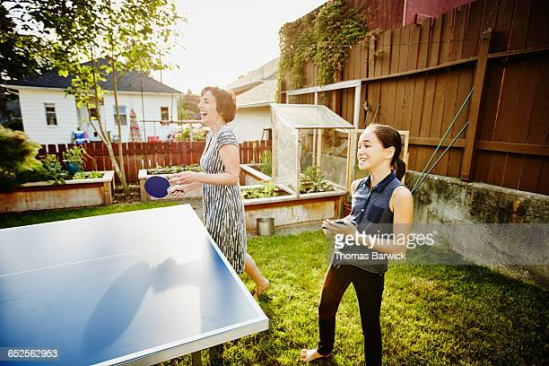 laughing mother and daughter playing ping pong - funny ping pong stock pictures, royalty-free photos & images