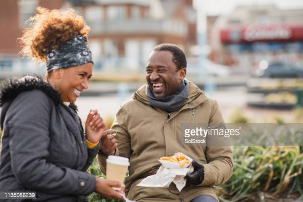 laughing over lunch - close to stock pictures, royalty-free photos & images