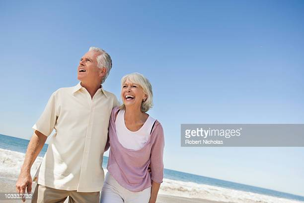 Laughing senior couple on beach