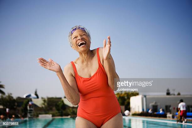 Laughing senior woman swimmer