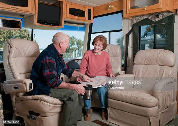 laughing seniors in motorhome - reclining chair stock photos and pictures