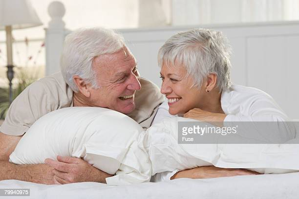 Laughing Seniors on Bed