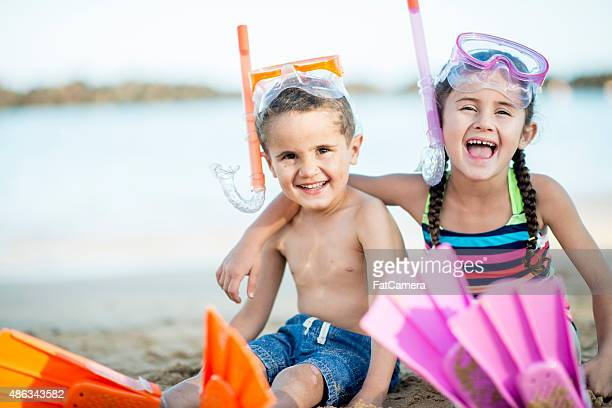 Laughing Siblings on the Beach