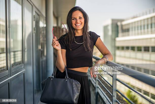a laughing smilling smart empowered woman - black shirt stock pictures, royalty-free photos & images