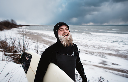 Laughing surfer with beard, beside Lake Ontario in winter - gettyimageskorea