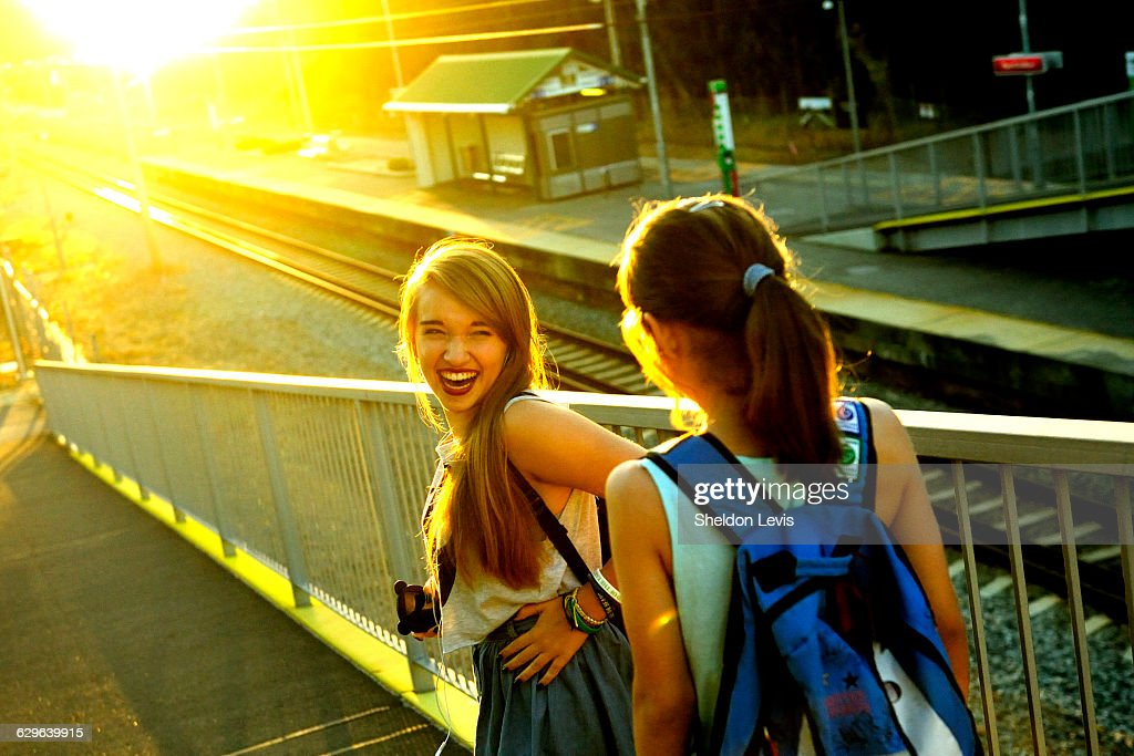 Laughing teenage sisters : Stock Photo