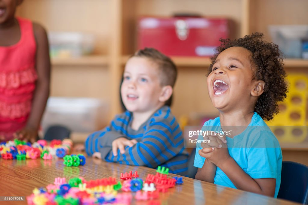 Laughing Together in Class : Stock Photo