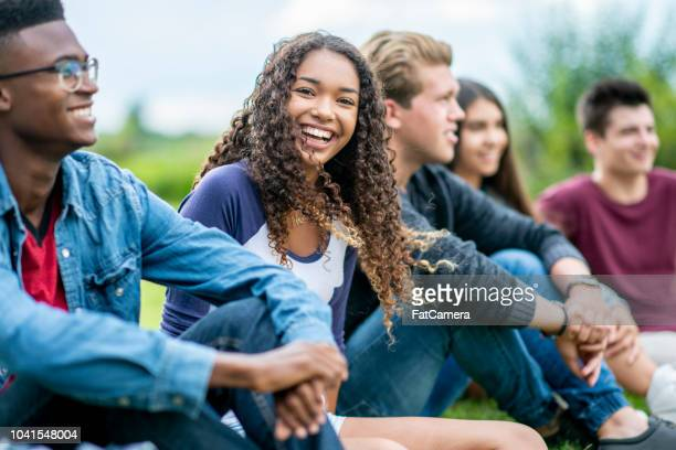 laughing with college friends - junior level stock pictures, royalty-free photos & images