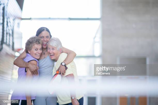 laughing with friends - community centre stock pictures, royalty-free photos & images