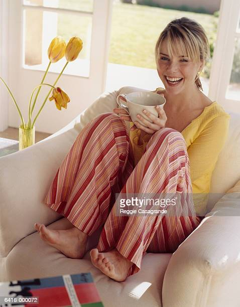 laughing woman holding mug - nightdress stock pictures, royalty-free photos & images