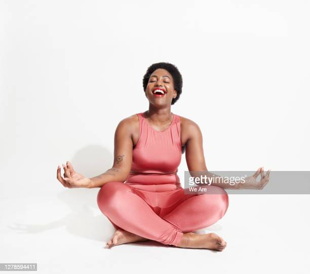 laughing woman in lotus position - relaxation exercise stock pictures, royalty-free photos & images