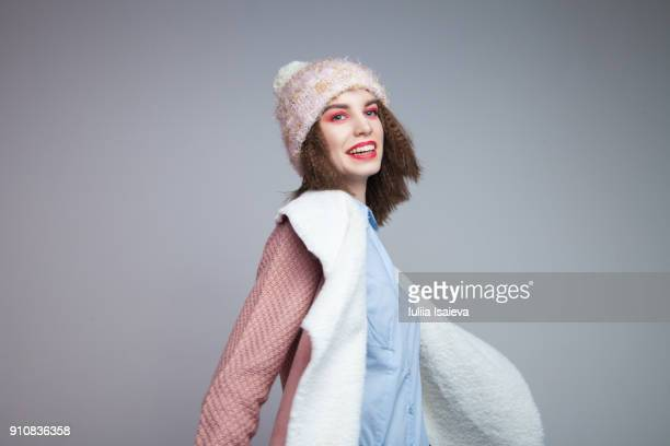 Laughing woman in warm clothes