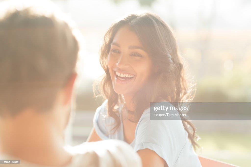 Laughing woman looking at man : Stock Photo