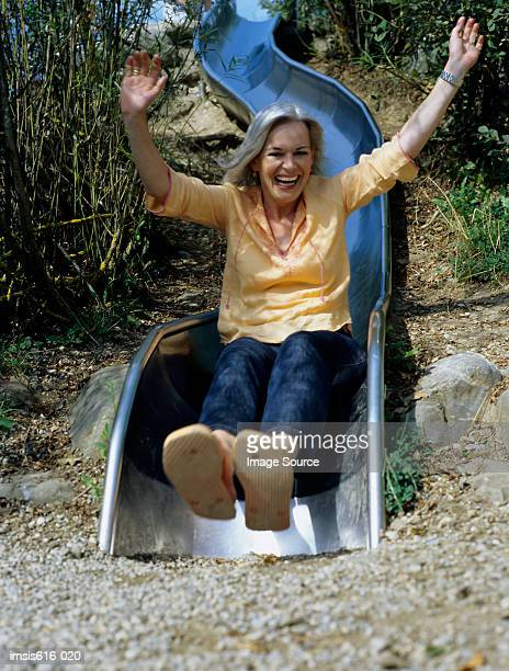 Laughing woman on slide.