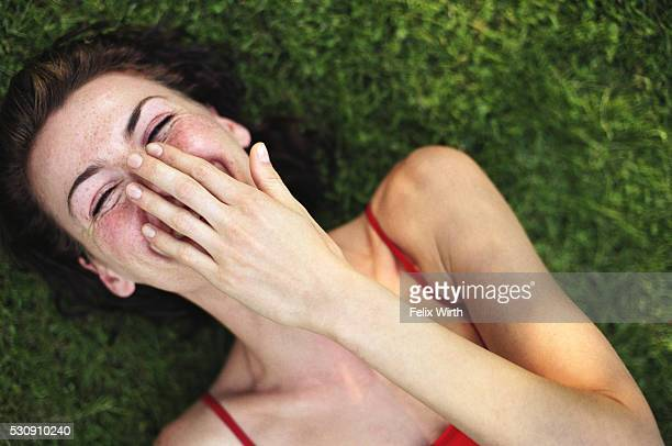 Laughing woman on the grass