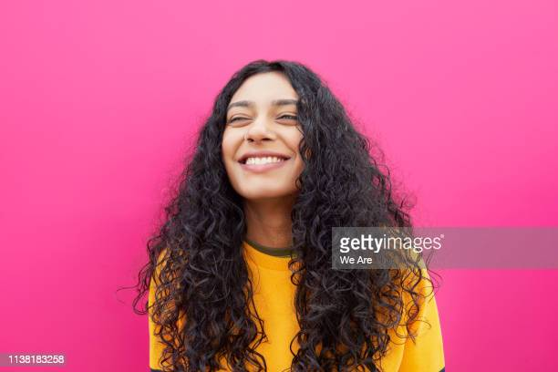 laughing woman - colored background stock pictures, royalty-free photos & images