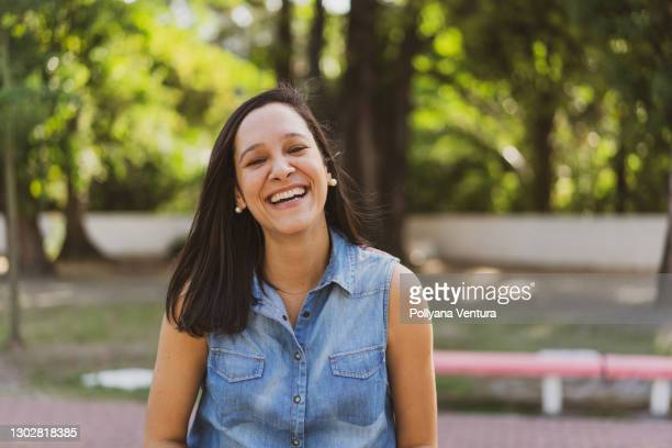 laughing woman portrait - black hair stock pictures, royalty-free photos & images