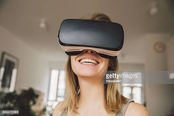 Laughing woman wearing virtual reality glasses