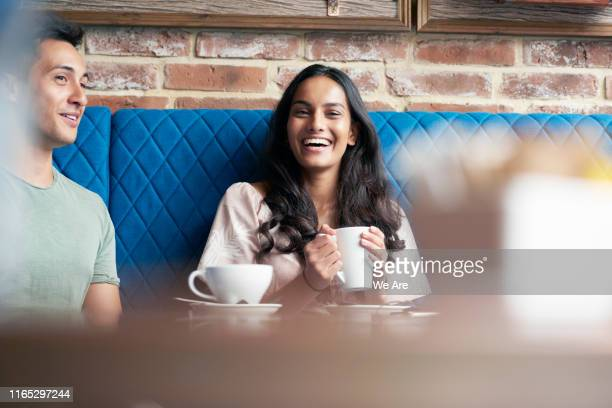 laughing woman with a cup of coffee - coffee stock pictures, royalty-free photos & images