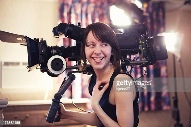 laughing woman with camera - cinematographer stock pictures, royalty-free photos & images