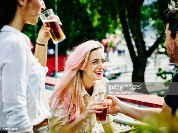 Laughing woman with friends during party