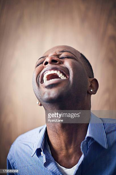 laughing young african american man - hysteria stock pictures, royalty-free photos & images