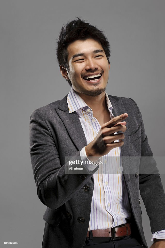 Laughing young guy : Stock Photo
