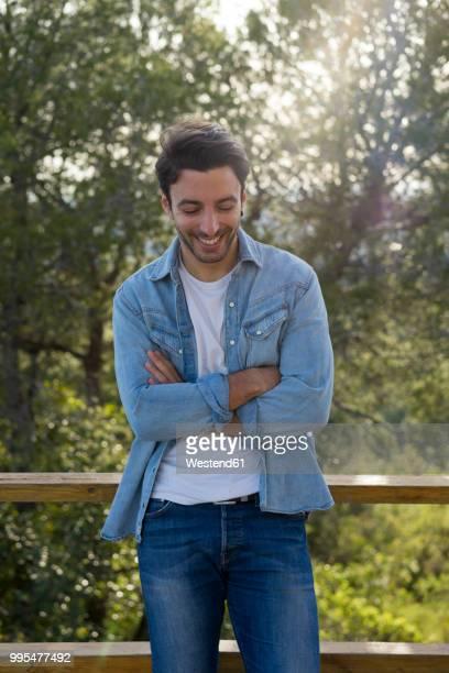 laughing young man - デニムシャツ ストックフォトと画像