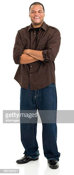 laughing young man standing - brown jeans stock photos and pictures