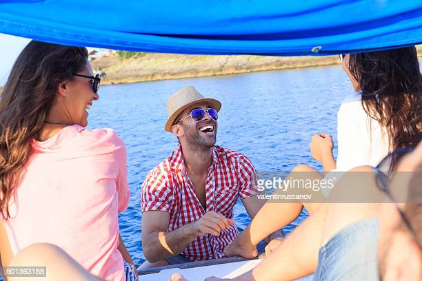 Laughing young people on boat