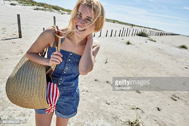Laughing young woman on the beach
