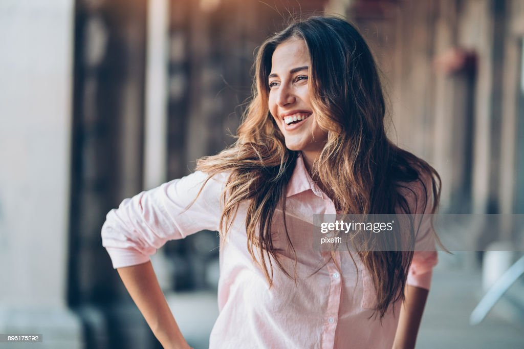 Laughing young woman : Stock Photo
