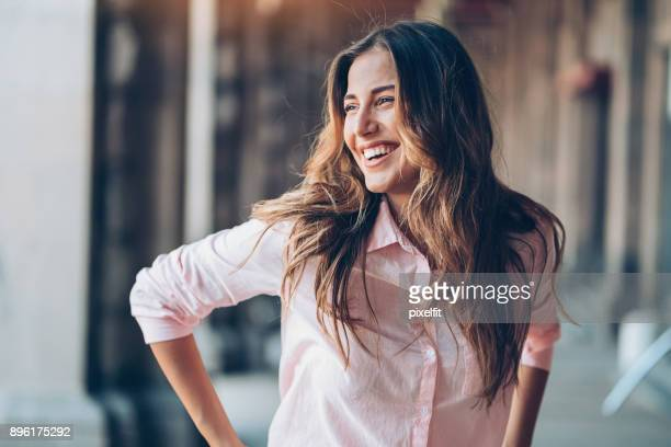 laughing young woman - top garment stock photos and pictures