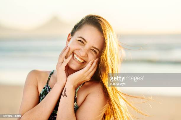 portrait carefree young woman smiling with