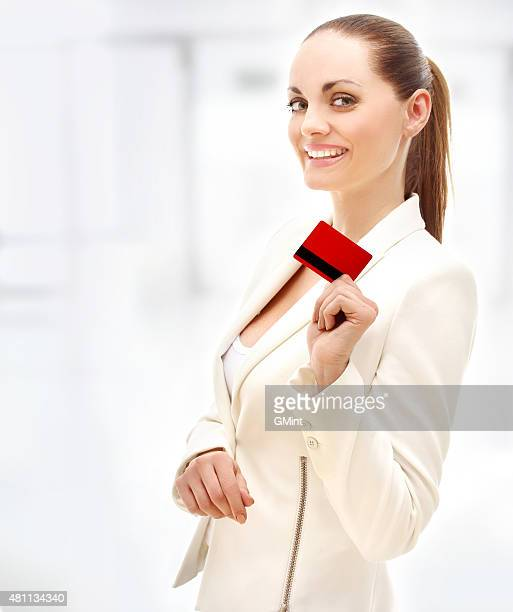 Laughing  young woman with credit card