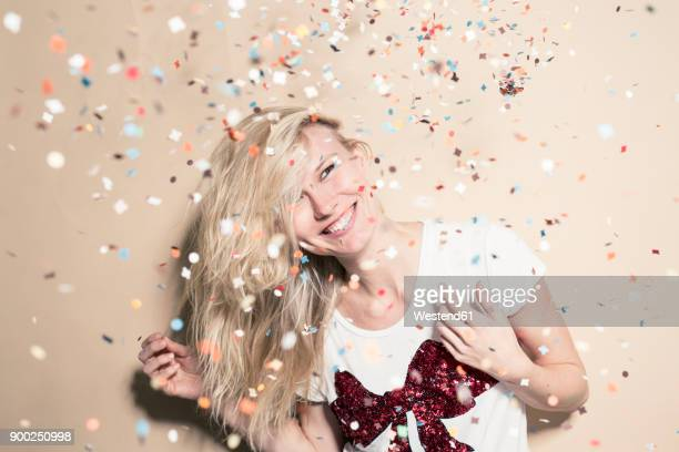 laughing young woman with flying confetti - flying solo after party bildbanksfoton och bilder